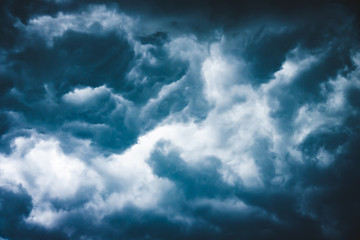 Dramatic sky with stormy blue clouds. Wall mural