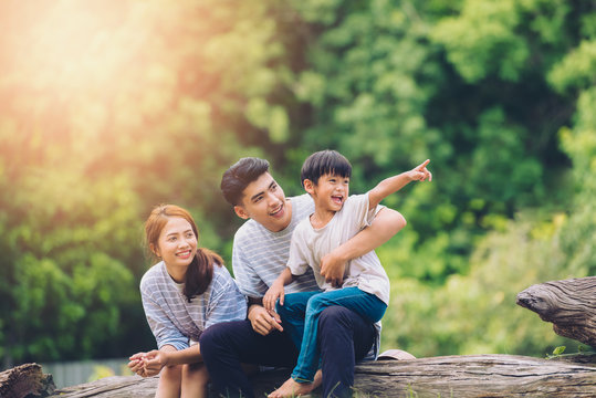 happy harmonious family outdoors concept.father mother and son have activities together on holidays.