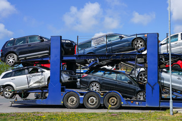 Car carrier trailer with used cars for sale on bunk platform