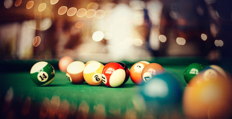 Colorful billiard balls on a billiard table.