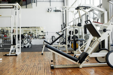 Modern gym interior with equipment. New modern gym or fitness club with sport equipment.