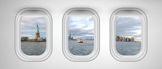 Wall Mural - New York City and Statue Of Liberty as seen through three aircraft windows. Holiday and travel concept