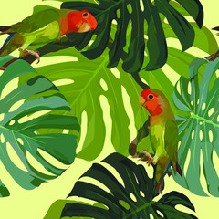 Seamless pattern. Tropical exotic picture - bright green parrots with a red head, large palm leaves. The background is yellow. Wallpaper, poster, fabric.