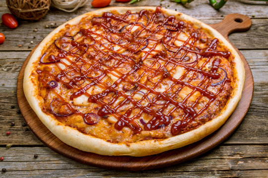 Pizza with meat and barbecue sauce