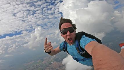 Parachutist doing a selfie in a wonderful sky Wall mural
