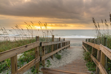 Boardwalk Leading to the Beach at Sunrise
