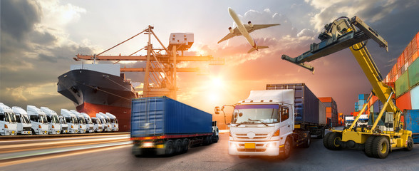 Wall Mural - Container truck in ship port for business Logistics and transportation of Container Cargo ship and Cargo plane with working crane bridge in shipyard at sunrise, logistic import export and transport