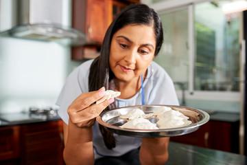 Woman enjoying cooking ravioli