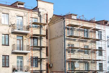 renovation of old building facade. metal scaffolding near wall