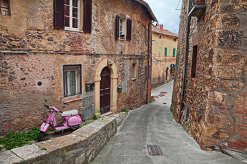 Sarteano, Siena, Tuscany, Italy:  ancient alley with a pink Vespa scooter
