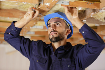 man working with ceiling