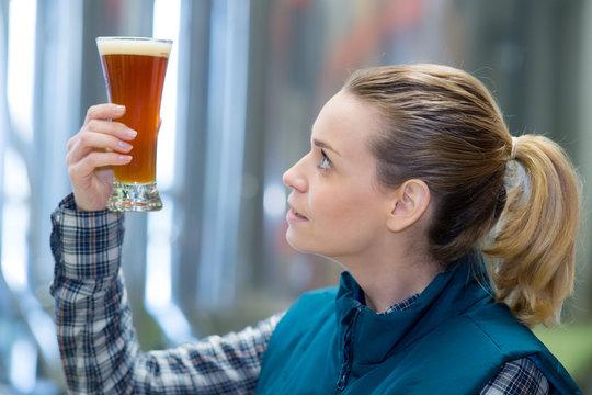 woman tasting beer