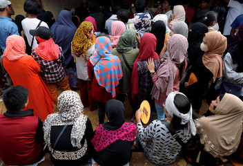 Voters wait outside a makeshift polling precint for internally displaced people in Marawi City