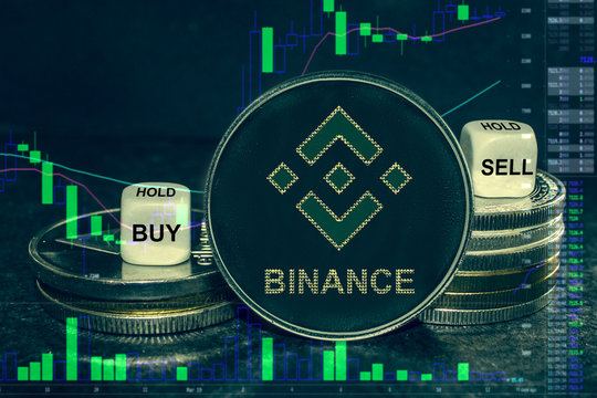 coin cryptocurrency bnd stack of coins and dice. Exchange chart to buy, sell, hold.