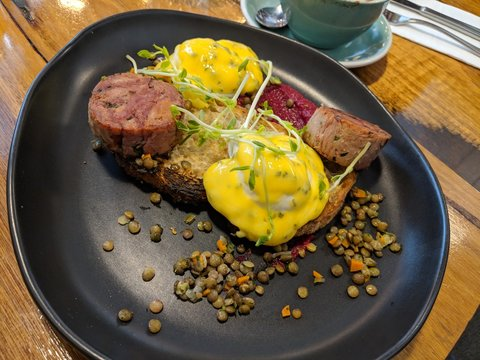 Eggs Benedict with Ham Hock,pickled lentils,beetroot puree and Bearnaise