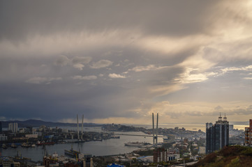 Wall Mural - Vladivostok cityscape - storm over city. Toned image.