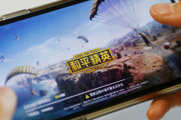 """Illustration picture of """"Game for Peace"""", Tencent's alternative to the blockbuster video game PUBG in China, on a mobile phone"""