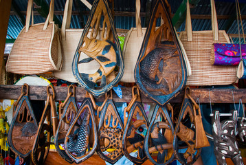 Souvenirs in the Amazon rainforest made from local nuts and animals near Iquitos. Market for tourists on the Amazon river. Amazonas, Brazil