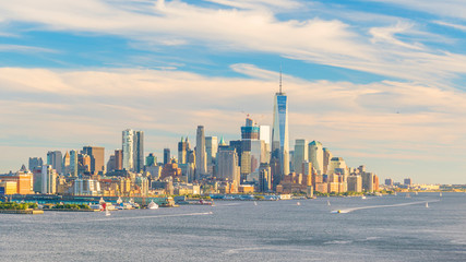 Fototapete - New York City downtown Manhattan sunset skyline panorama view over Hudson River