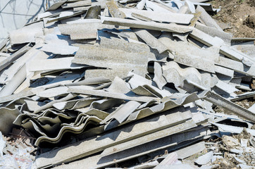 Broken asbestos roof, asbestos removal