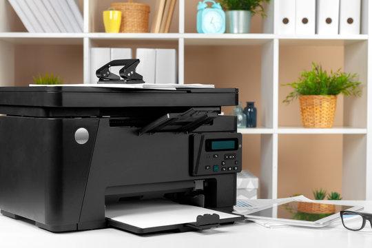 Printer, copier, scanner in office. Workplace.