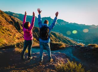 happy couple enjoy travel at sunset mountains