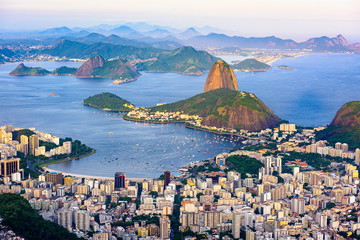 Fototapete - The mountain Sugarloaf and Botafogo in Rio de Janeiro, Brazil. One of the main landmark of Rio de Janeiro. Sunset skyline of Rio de Janeiro