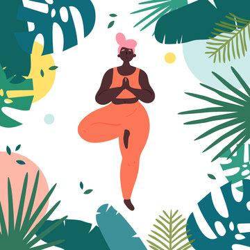 Woman in vrksasana yoga tree asana pose
