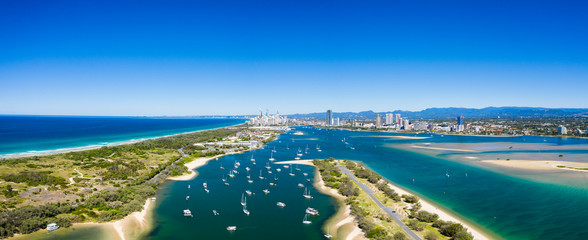 Panoramic sunny view of boats around the Spit and the Gold Coast seaway