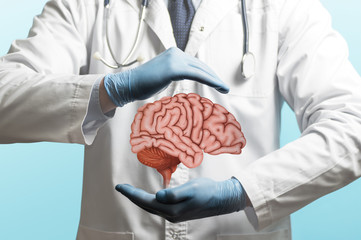 Image of a doctor in a white coat and brain above his hands. Neurosurgery. Treating of a brain.