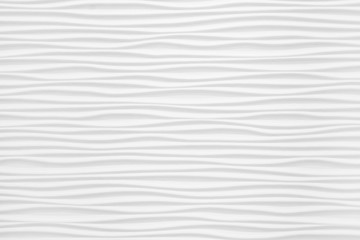 Beautiful and voluminous white wall surface in the form of waves. Gypsum panels for finishing walls...