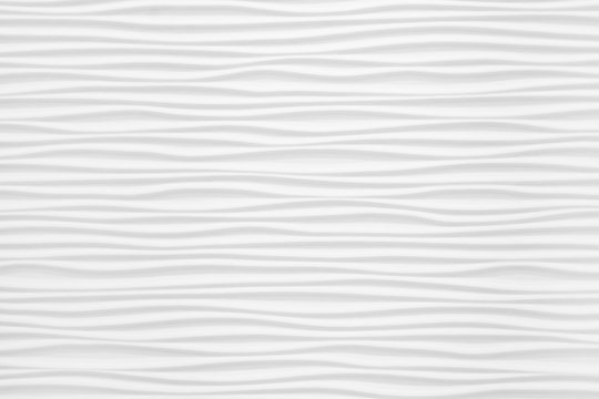 Beautiful and voluminous white wall surface in the form of waves. Gypsum panels for finishing walls in the form of waves
