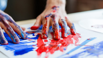 Art therapy lifestyle. Man hands in red blue paint closeup. Recreation relaxation. Artist talent creative style technique.