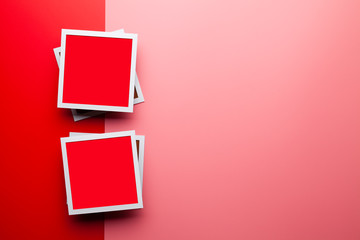 Two white and red photo frames on red and pink background