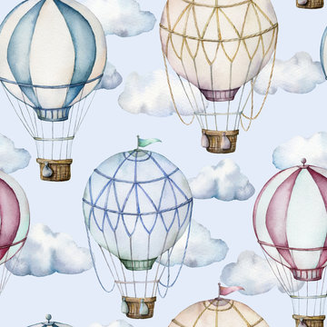 Watercolor seamless pattern with hot air balloons and clouds. Hand painted sky illustration with aerostate isolated on pastel blue background. For design, prints, fabric or background.