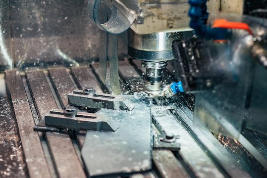 Industrial metalworking CNC water jet cutting metal.