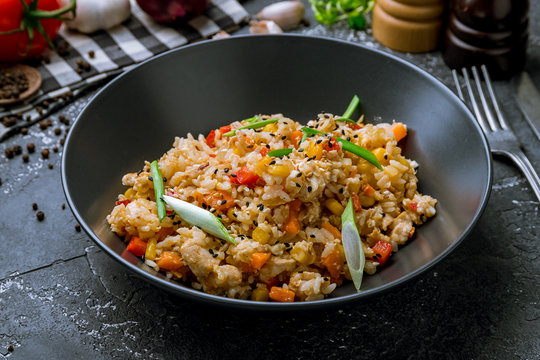 fried rice with chicken , egg and vegetables