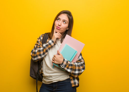 Young student woman doubting and confused