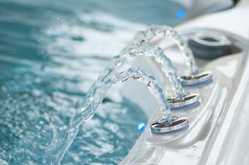 closeup of jet of water in swirl bath