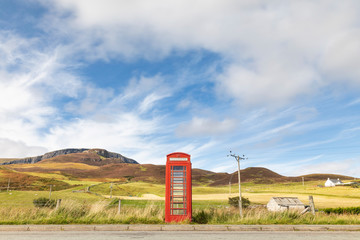 United Kingdom, Scotland, red phone booth in the countryside on the Isle of Skye