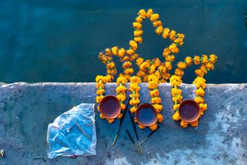 Peoples is kindling lamp with flowers in evening time varanasi, uttar pradesh, Varanasi, India