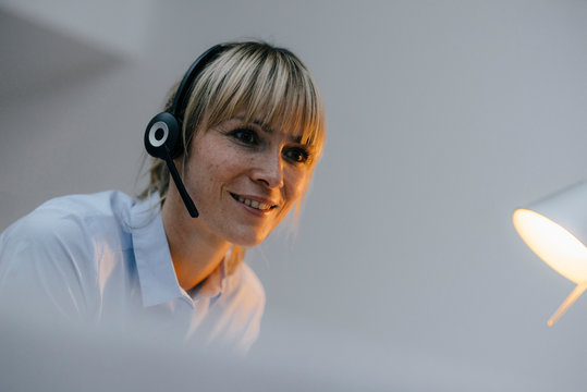 Businesswoman having a conference call with headset