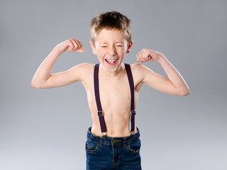 Thin boy showing muscles