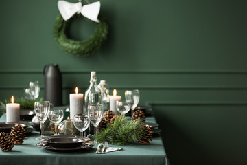 Elegant table set for christmas dinner, copy space on empty green wall Fototapete