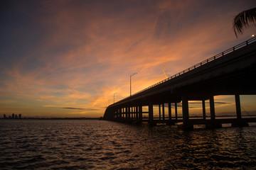 view of the Rickenbacker bridge at dawn