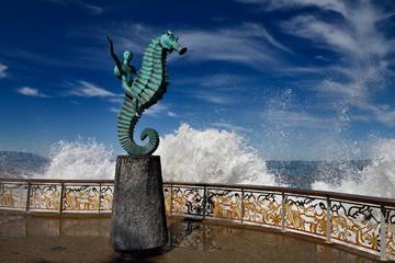 The Boy on a Seahorse sculpture Puerto Vallarta Malecon with splash of Pacific sea