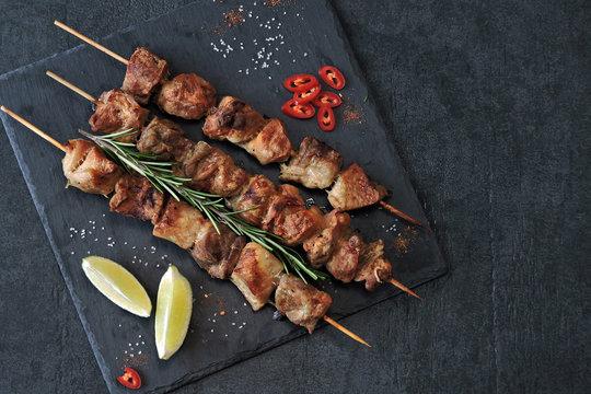 Appetizing kebab on wooden sticks. Keto Paleo. Pegan Diet.