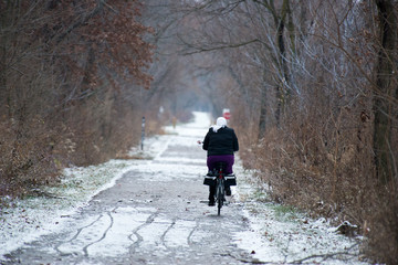 Amish Woman Riding Bike on Trail in Winter