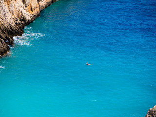 Lone diver in a amazing blue cove - crystal blue sea