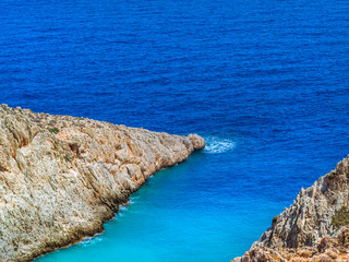 Different shades of blue - rocky hills and amazing blue sea
